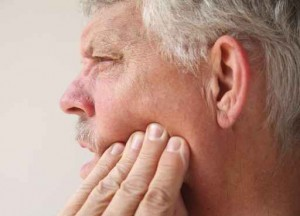 man with tooth or jaw pain